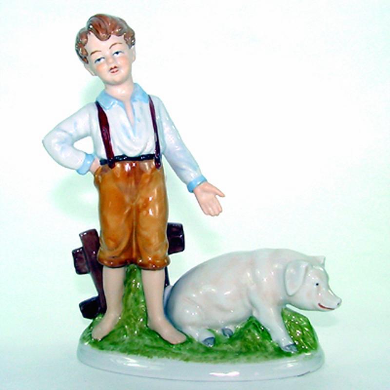 Junge mit Schwein Porzellan H 22 cm