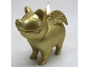 Kerze. Gold. Schwein mit Flügeln